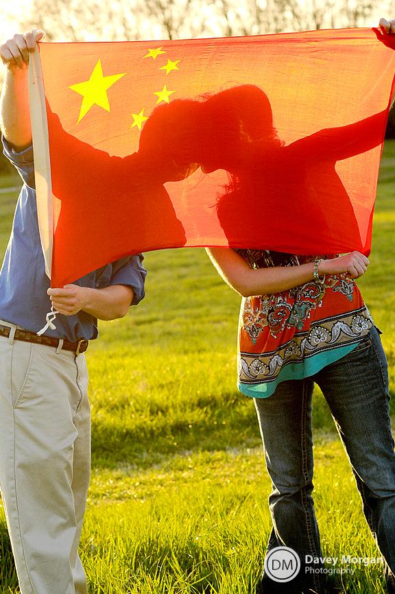 Kissing behind Chinese Flag