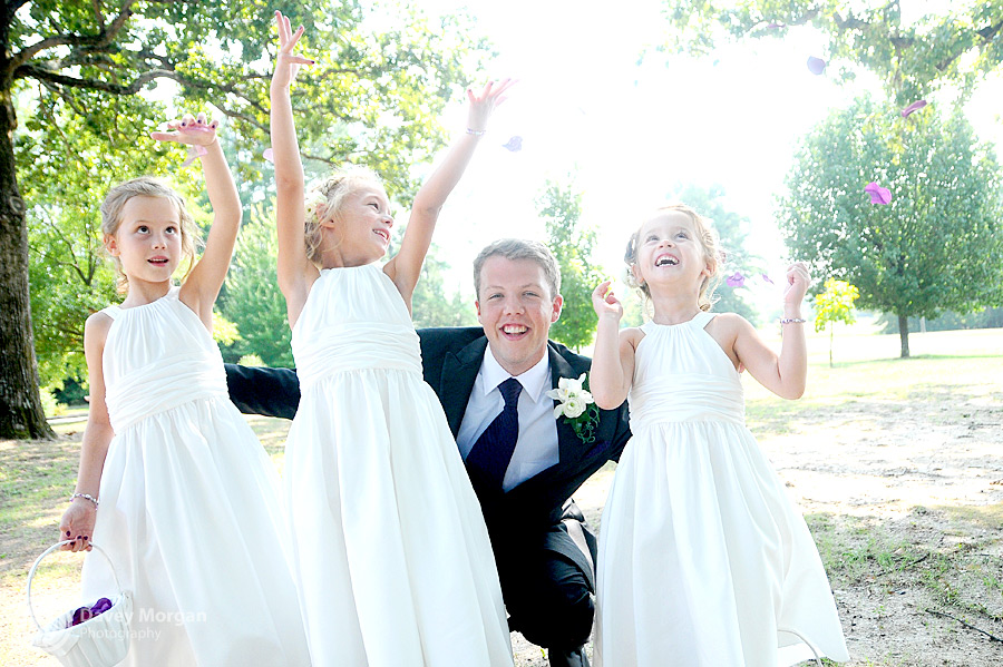 Flower girls throwing flowers in the air | Davey Morgan Photography