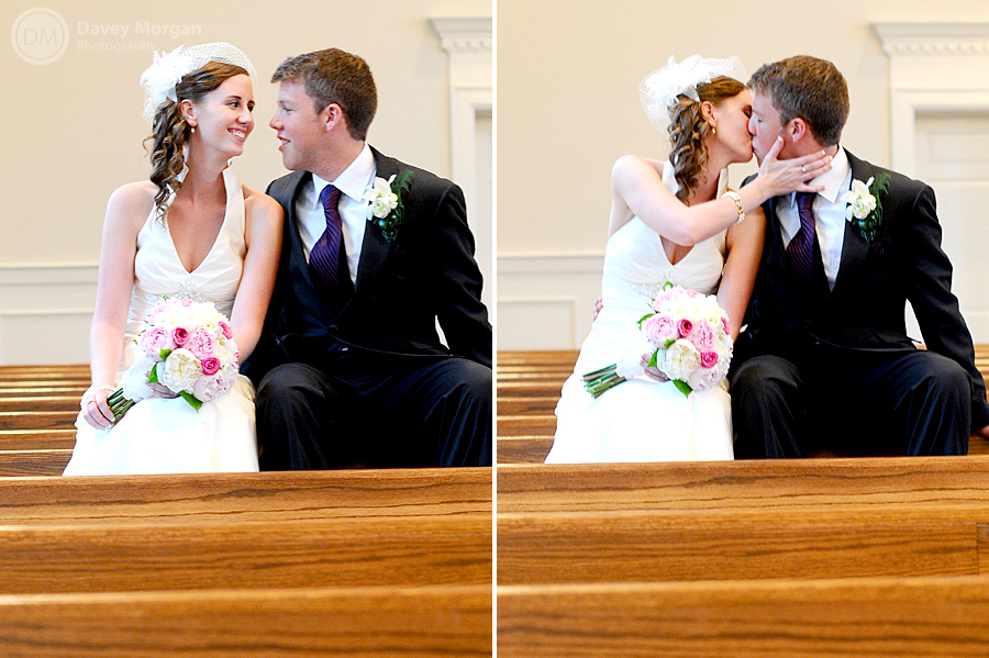 Bride and Groom sitting on church pew kissing | Davey Morgan Photography