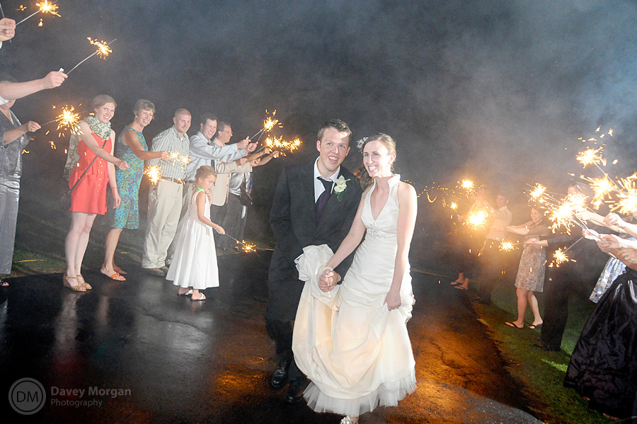 Running through sparklers at wedding reception | Davey Morgan Photography