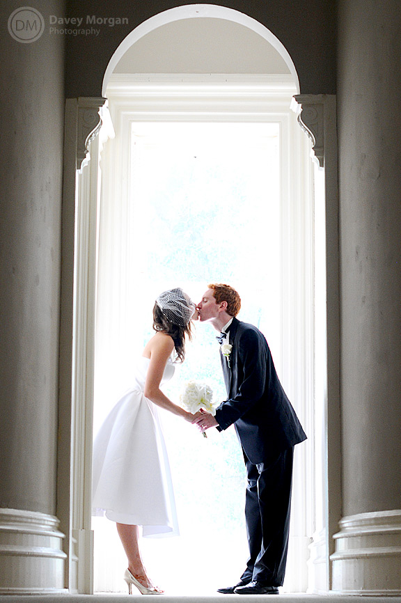 Bride and Groom Kissing in archway | Davey Morgan Photography