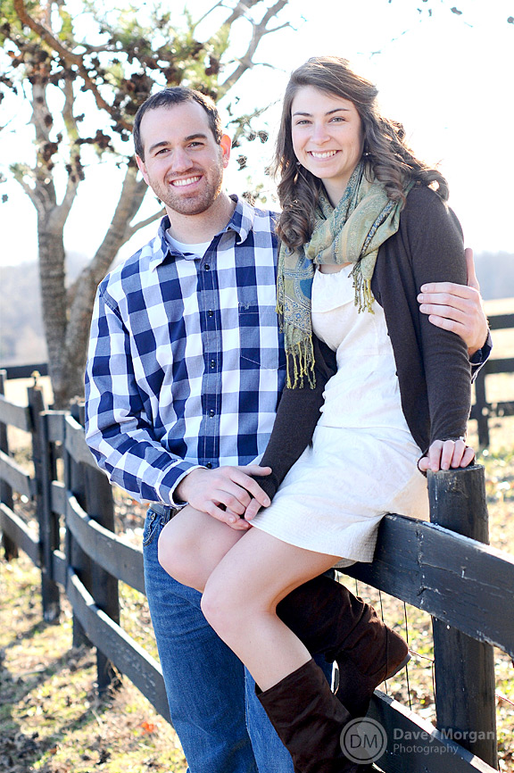 Engaged couple sitting on fence | Greenville, SC | Davey Morgan Photography