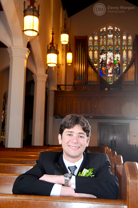 Groom sitting in pew at Church | Davey Morgan Photography
