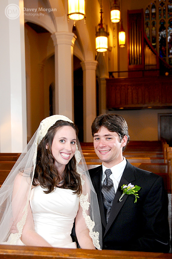 Bride and groom sitting in church pew | Davey Morgan Photography