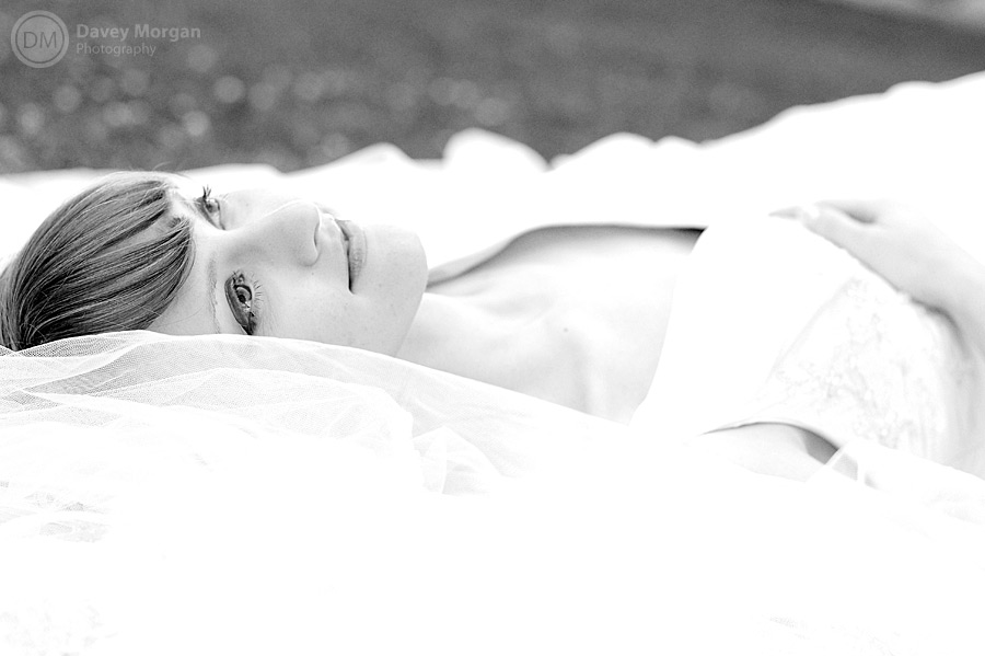 Bride laying on the ground in Columbia, SC | Davey Morgan Photography