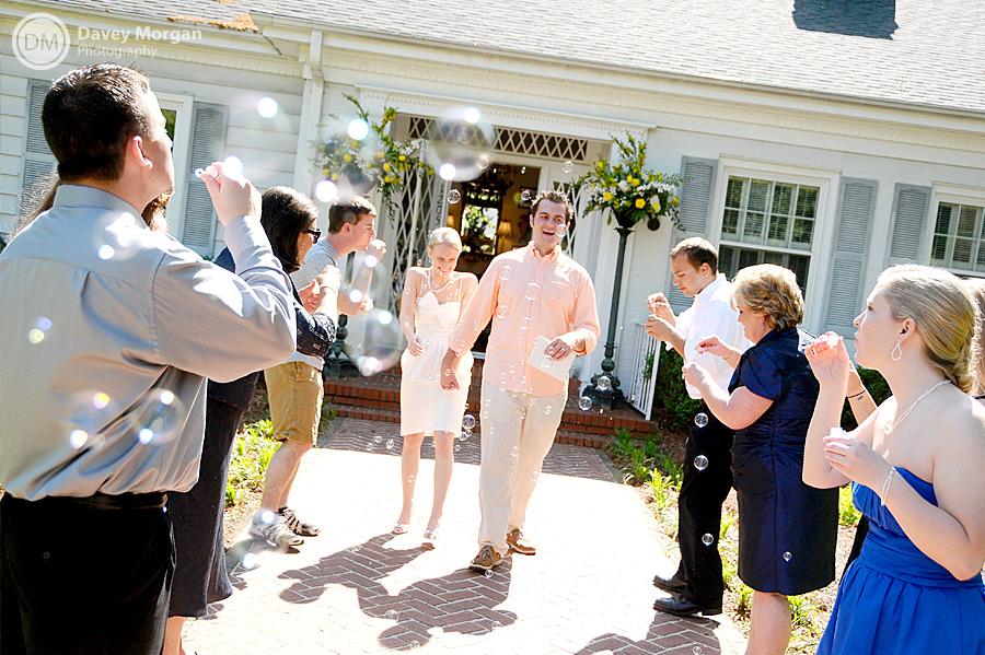 Bride and Groom leaving through bubbles at wedding reception | Davey Morgan Photography
