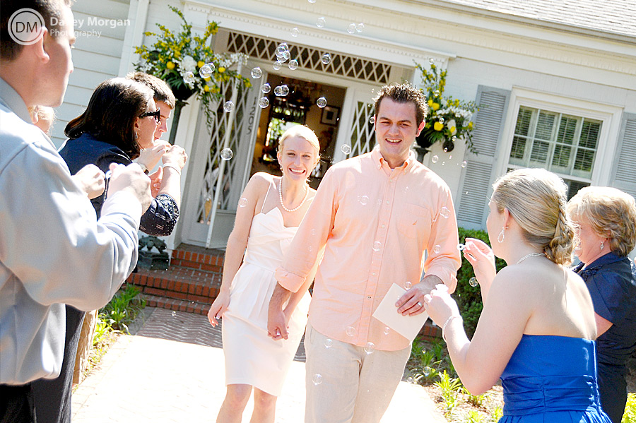 Blowing bubbles at bride and groom | Davey Morgan Photography
