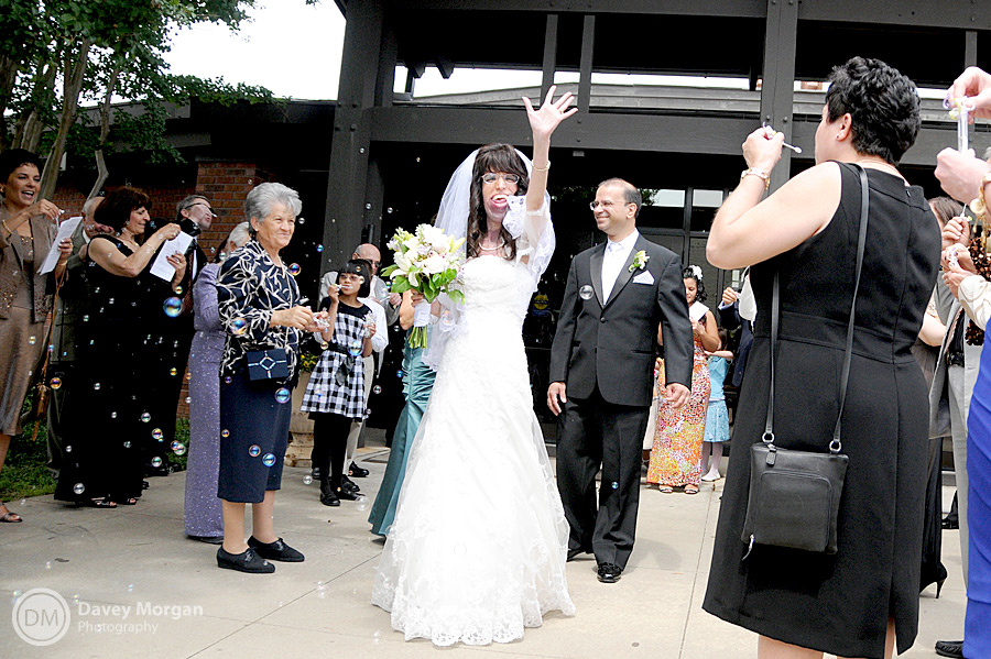 wedding guests blowing bubbles | Davey Morgan Photography