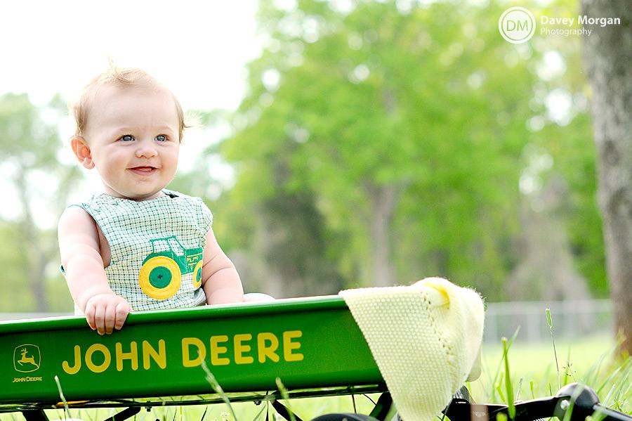 Baby in job in John Deere wagon | Davey Morgan Photography