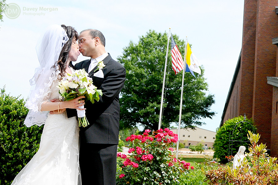 couple kissing in front of church | Davey Morgan Photography