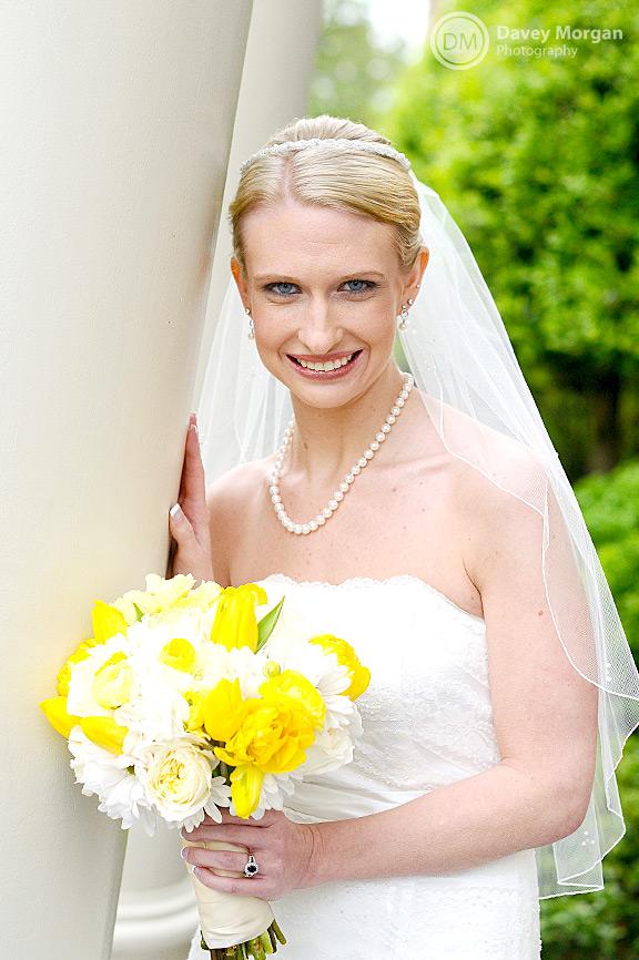 Bride standing next to church column | Davey Morgan Photography