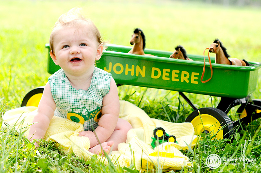 Baby with in John Deere wagon | Davey Morgan Photography