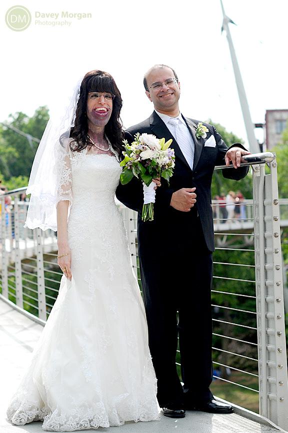bride and groom at liberty bridge in falls park | Davey Morgan Photography