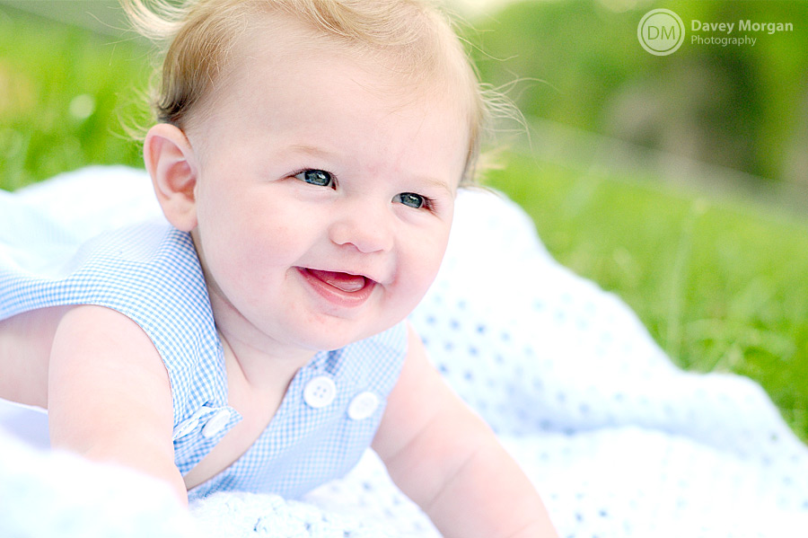 baby smiling and laying on blanket | Davey Morgan Photography