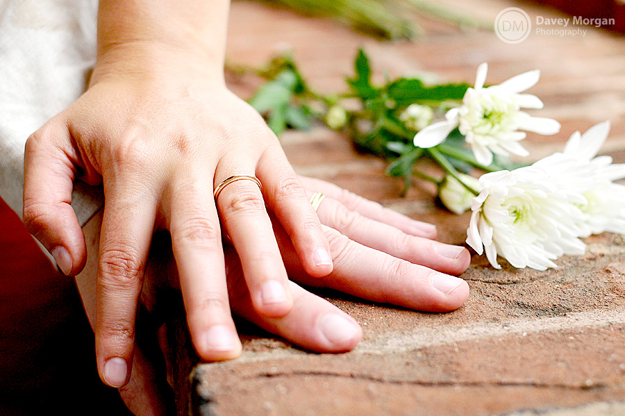 rings showing with hands on each others and flowers picture | Davey Morgan Photography