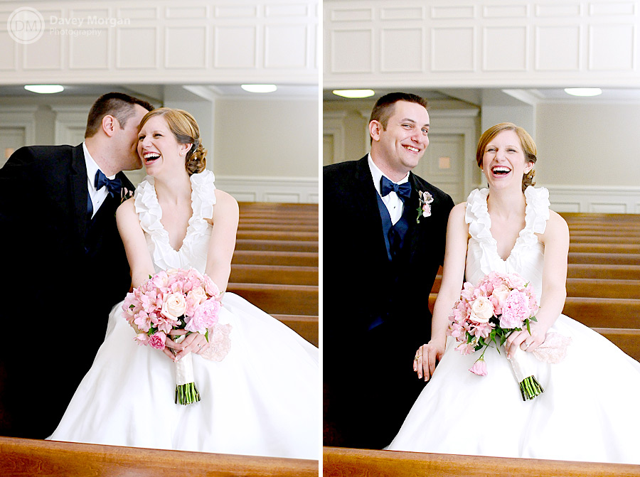 Newlywed couple sitting on pew in church | Davey Morgan Photography