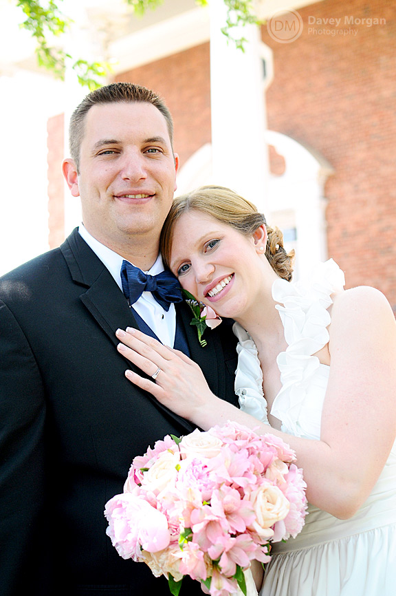 Newlywed couple standing in front of church | Davey Morgan Photography