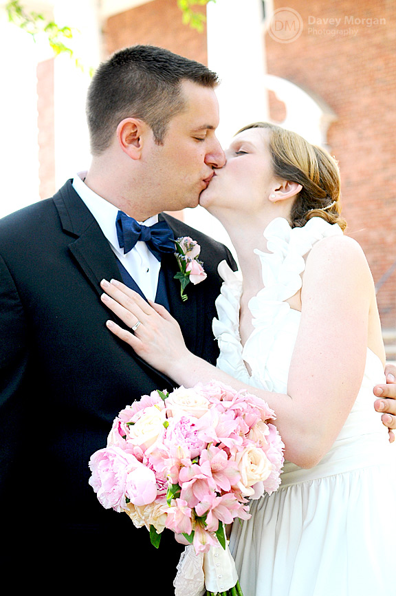 Newlywed couple kissing in front of church | Davey Morgan Photography