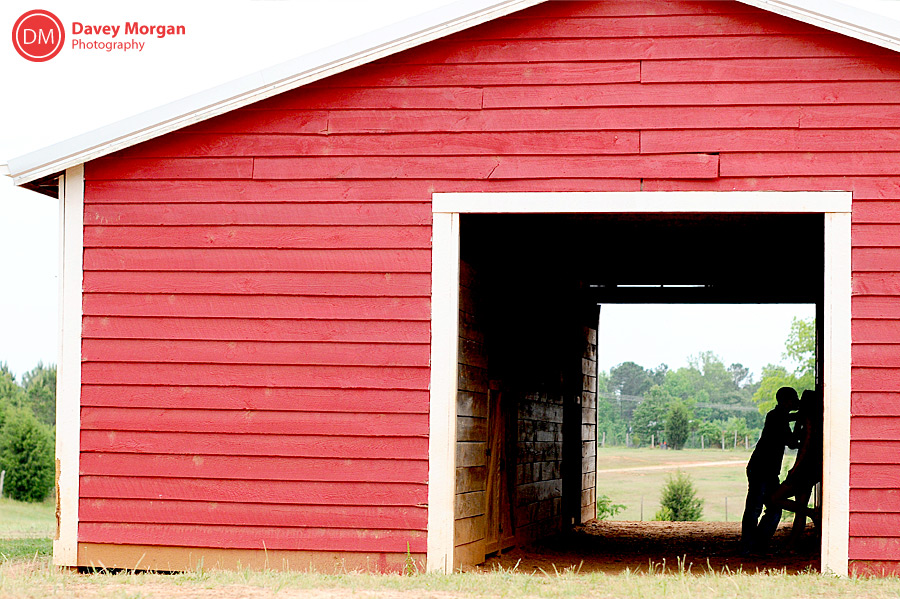engagement picture silhouette in a red barn  | Davey Morgan Photography
