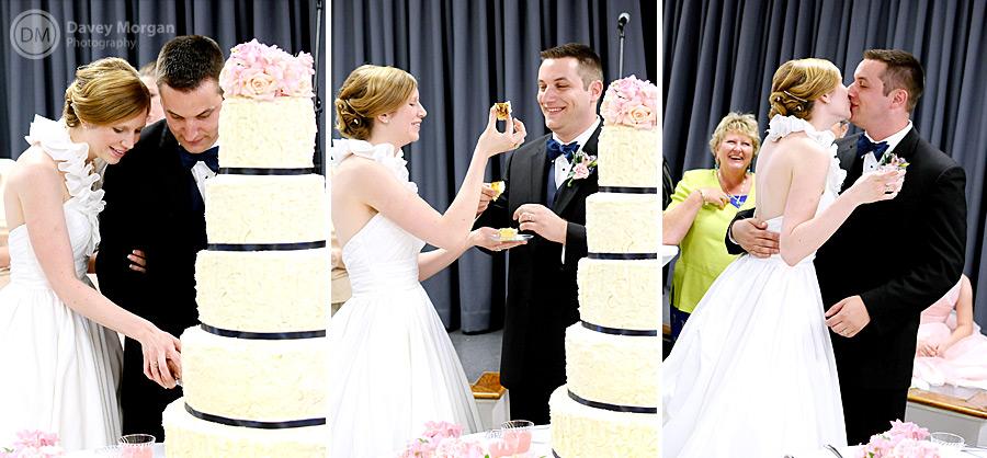 Newlyweds cutting the wedding cake | Davey Morgan Photography
