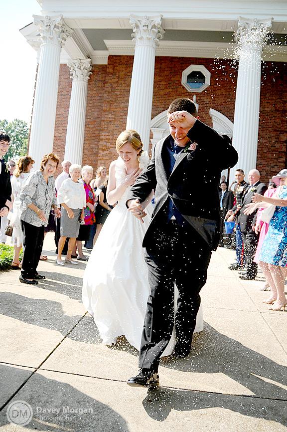 Newlyweds leaving through bird seeds | Davey Morgan Photography