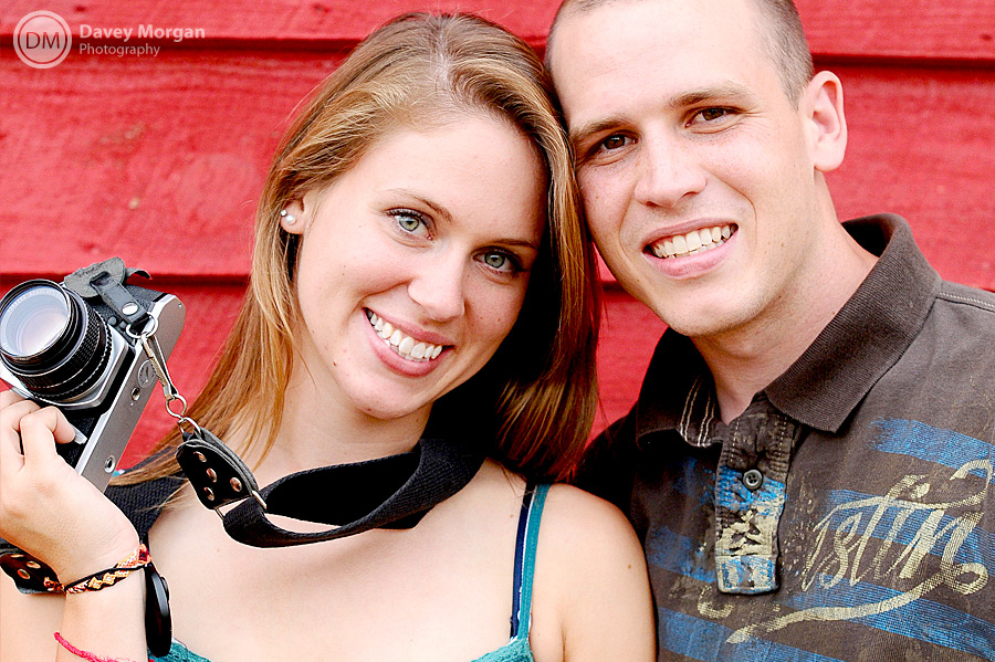 red barn engagement picture of a photographer with a pentax camera  | Davey Morgan Photography