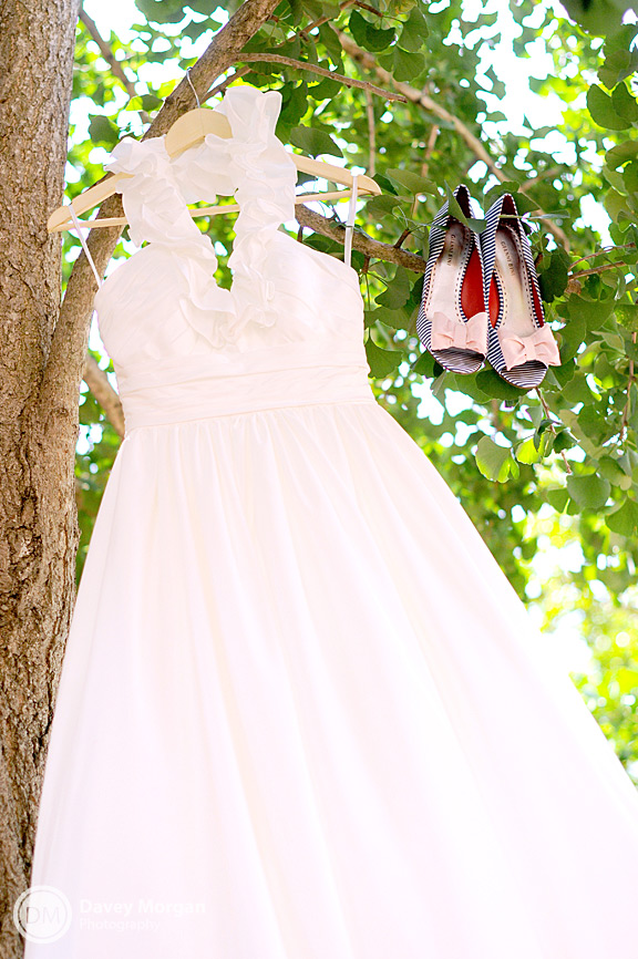 Wedding Dress hanging in a tree with shoes | Davey Morgan Photography