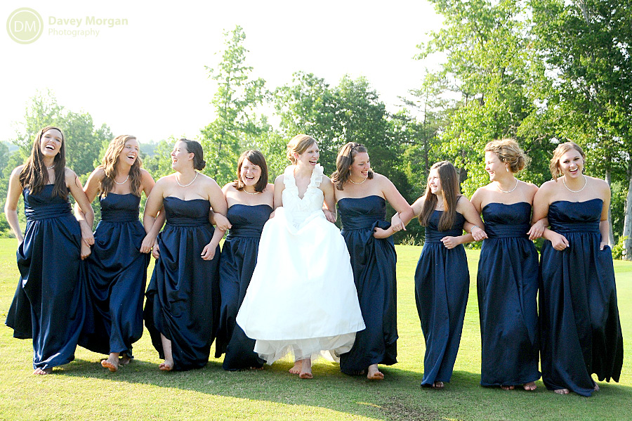 Bride and bridesmaids walking with arms linked picture | Davey Morgan Photography
