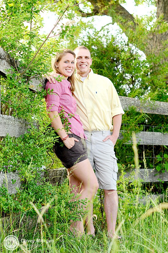 Engagement pictures leaning on a fence | Davey Morgan Photography