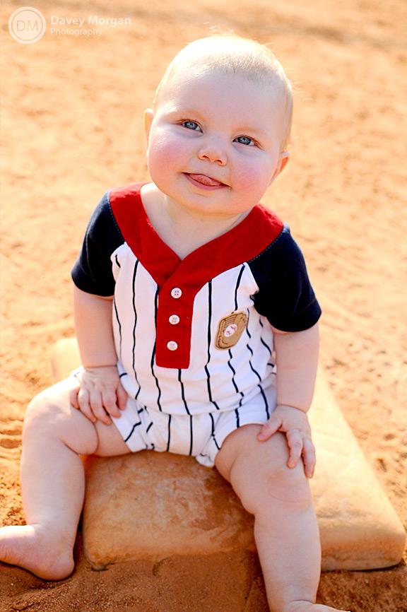 Baby sitting on baseball base | Davey Morgan Photography