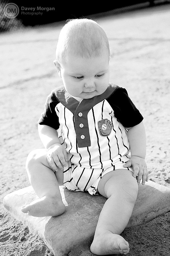 black and white of baby on baseball plate | Davey Morgan Photography