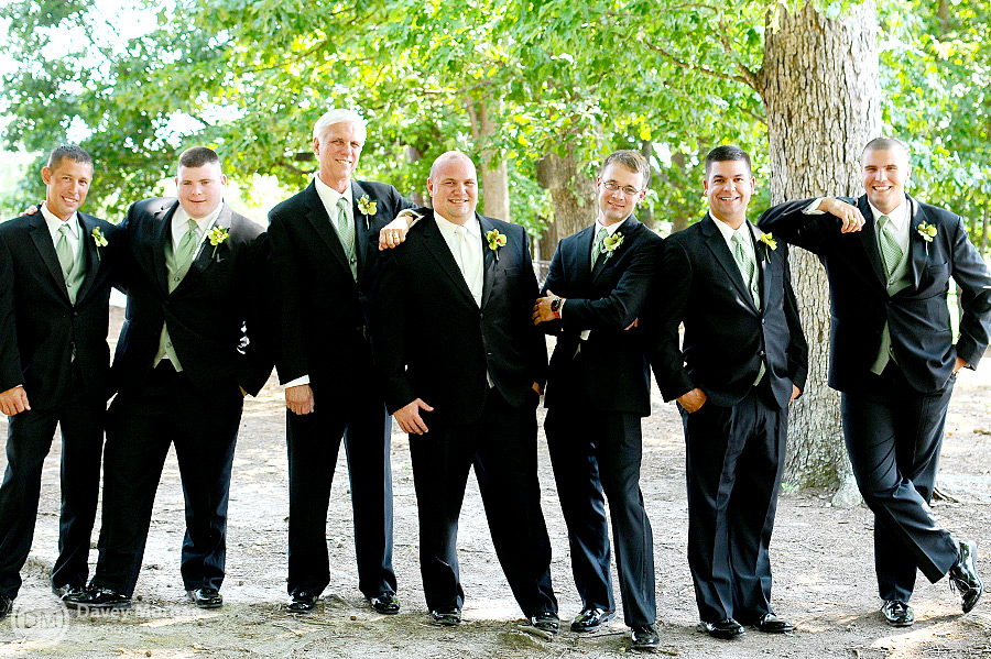 Groom and groomsmen standing outside the church | Davey Morgan Photography