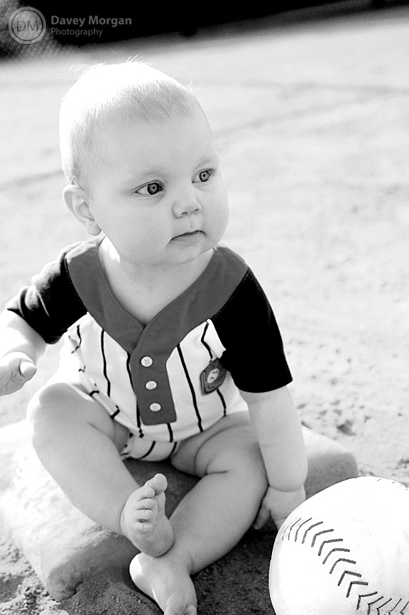black and white of baby with baseball | Davey Morgan Photography