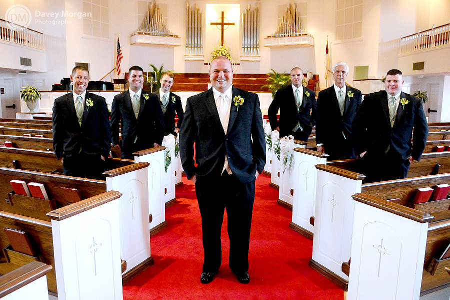 Groom and groomsmen standing in church scattered | Davey Morgan Photography