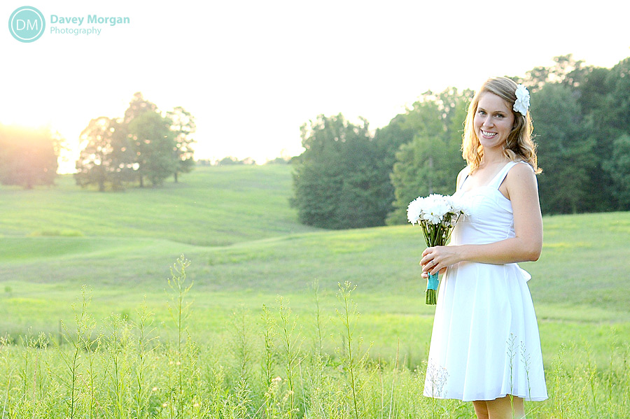 Bride in a field with rolling green hills | Davey Morgan Photography