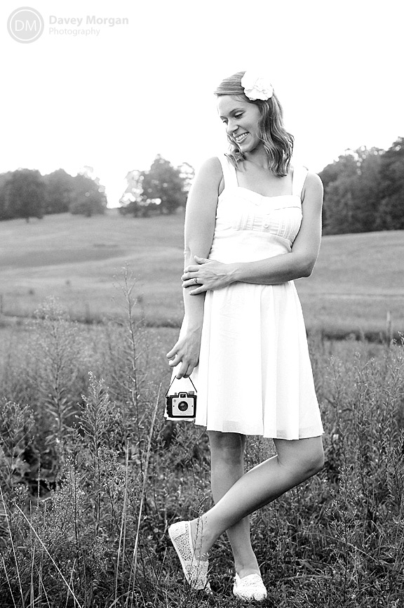 Bride in a field with a vintage brownie camera | Davey Morgan Photography