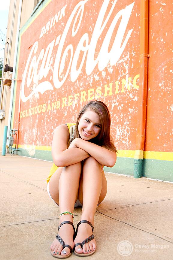 Senior Portrait at Coca Cola Sign in Greenville, SC | Davey Morgan Photography
