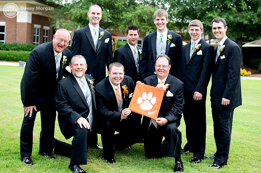 Groom and Groomsmen holding a Clemson Flag with tiger paw  | Davey Morgan Photography