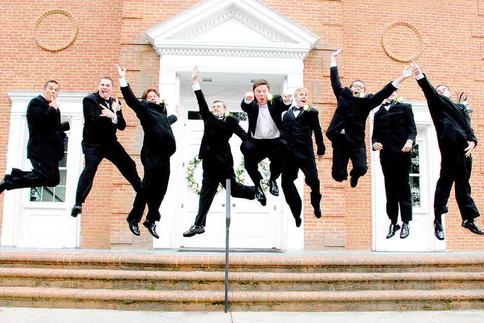 Nikon Moving Moments Photo Contest award winning photo of groomsmen jumping at a wedding